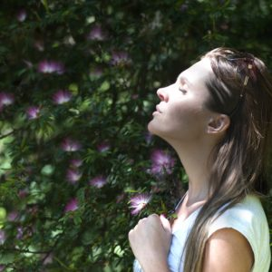 woman taking break from social media cleanse in nature